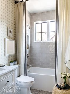 A bathroom's hand-painted organic wall coordinates with the bedroom, and the ebb and flow of the suite is versatile to suit anyone. Woven Grass, Interior Details, Shower Tile, Wall Spaces, Interior, Wall Coverings, Upstairs Bedroom, Bath Countertops, Window Coverings