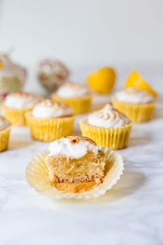 Perfectly fluffy lemon cupcakes, filled with a smooth and zesty lemon curd and topped with a toasted meringue frosting you would never guess didn't contain eggs.