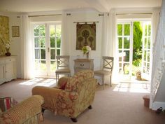 French Cottage Gardens | Sitting Room with french doors to garden
