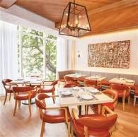 2015 Top 100 Hot Spot Restaurants in America | FIG & OLIVE extends an olive branch to Chicago with its natural limestone and white stucco walls surrounding an open-exhibition kitchen, an expansive lounge and bar, a crostini station, and an open-air garden terrace. The menu draws influence from the French Rivera.