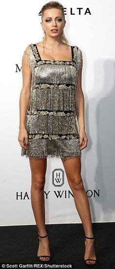0a8bb5296edc Fringe benefits: Caroline Vreeland sported a silver mini dress and black  heels .