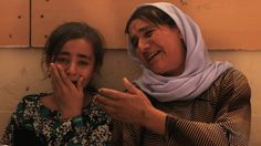 """More than 3,000 Yazidi women and children have been captured by Islamic State militants and are reportedly being trafficked for sex. One young woman who escaped told BBC News she saw girls as young as nine being sold. The Yazidis are asking for support to bring back their girls and have drawn up lists of those they're searching for.  """"They took all our girls. It's all we care about. The world must help us,"""" said one woman whose two daughters are missing."""