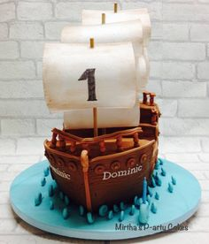 "My version of a pirate ship carved out of Madeira cake, this sits on a 16"" board and had edible sails made of wafer paper"