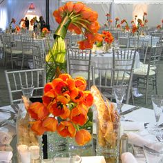 Vibrant orange flower arrangements from Church Street Florals and silver chiavari chairs from Chair-man Mills spiced up the dining space dur... Photo: Courtesy of BizBash