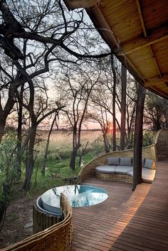 The Okavango Delta and the areas surrounding Sandibe Safari Lodge is renowned for its abundant wildlife where lions, cheetahs, leopards, red lechwe antelope and elephants are regular, roaming visitors. Design Hotel, House Design, Round Hot Tub, Game Lodge, Luxury Tents, Plunge Pool, Interior Design Magazine, African Safari, Spas