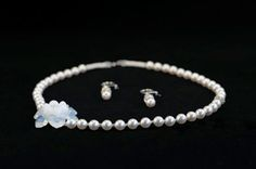 Handmade bridal set with Swarovski crystals, pearls and sterling silver.