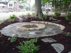 Flagstone Patio Around Natural Stone Fire Pit Fire Pit Area, Fire Pit Backyard, Backyard Patio, Backyard Landscaping, Backyard Seating, Backyard Ideas, Landscaping Ideas, Inexpensive Landscaping, Modern Landscaping