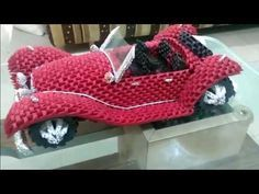 It is inspired by 1936 Mercedes Benz Roadster model. This Origami Car has around 4000 pieces of different colors. It is purely made from triangular pieces. Origami Rocket, Origami Set, Origami Toys, Origami Gift Box, Origami Videos, Origami Envelope, Kids Origami, Money Origami, Origami Paper Art