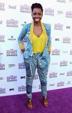 Nigerian/US Actress Adepero Oduye looking very chic in a slim fitted feminine trouser suit ( love the hint of yellow in the sleeve and collar).