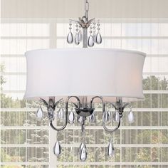 This lovely crystal chandelier is simple, yet elegant. Featuring a modern design for a streamlined look, it offers a polished chrome finish, dangling crystal accents, and a fabric shade. This chandelier requires three 60-watt chandelier bulbs.