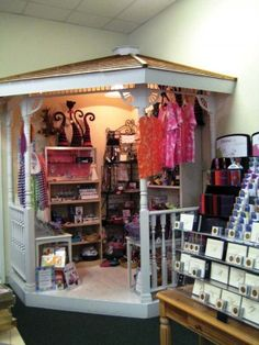 """This little corner gazebo, TGtbT.com thinks, would make a terrific """"Grandma's Corner"""" for special items in a childrenswear consignment shop, or (with some bright paint and tassels) a Boho Gypsy or funky vintage corner in a womenswear resale shop..."""