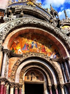 Basillica di San Marco - The mosaic depicting the interment of St. Mark's body, gives an accurate portrayal of what the church looked like in the 13th century, before the 15th century addition of elaborate white Gothic cresting.