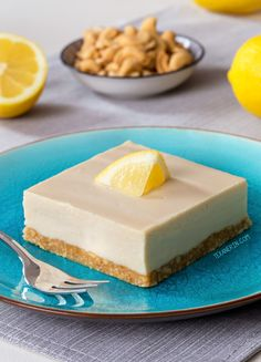 Paleo lemon bars with a super creamy, cashew-based vegan and no-bake topping! Full of lemon flavor and maple-sweetened and completely no-bake.