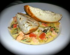 Gaelic Fish Stew:  Wild mushrooms, clams, salmon served with potatoes and bacon in a leek and garlic infused cream with crispy grilled bread