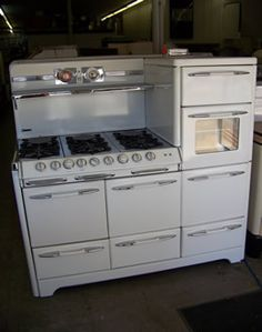 My dream appliance: 1953 O'Keefe & Merritt Aristocrat.  It has 2 full baking ovens, 2 Grill-a-vator broilers, a warming oven, storage drawer, 6 surface burners, condiments shelf and a clock & timer.