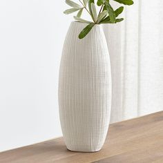 Textured lines enliven the surface of this graceful tall vase of cream-colored porcelain. Pair with our ring-shaped Alura open vase for extra sculptural impact. Large White Vase, Blue And White Vase, White Vases, Silver Vases, Vase Arrangements, Vase Centerpieces, Vases Decor, Floor Vase Decor, Tall Floor Vases