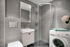 stilrent bad med grå fliser