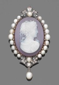 A late 19th century hardstone, pearl and diamond cameo brooch/ pendant