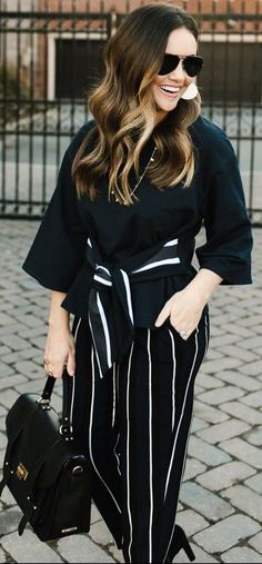 #winter #outfits black top, striped pants