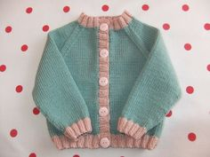 Hand knitted light teal and powder pink baby by TillyandLola, £28.50