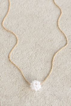 Make the ultimate, subtle statement in this long necklace that features a 'bunch…