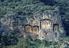 """obsessed w/ how these were built?! 500 BCE... [Image: The """"rock tombs of Caria, Kaunos, 4th century B.C.,"""" photographed by Takeo Kamiya]."""