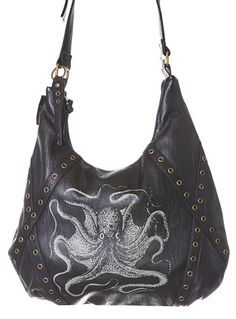 Ominous Octopus Hobo Bag at PLASTICLAND A large ivory colored vintage style Octopus illustration is printed on the front, and other details include a matching black faux leather shoulder strap along with antiqued brass hardware and eyelet stud trim.