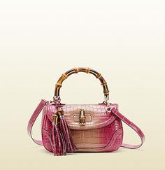 A favorite to carry hands down! Gucci- bamboo crocodile top handle bag.