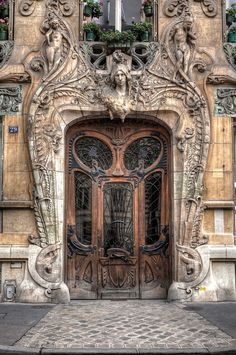 """""""Very interesting, beautiful door in Paris is the at 29 Avenue Rapp in the 7th arrondissement, very close to the Eiffel Tower. Built in 1901, this Art Nouveau masterpiece by Jules Lavirotte is quite striking. The detailed door was designed by sculptor Jean-Baptiste Larrive and sculpted by a variety of others""""."""