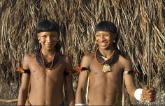 Brazil | Enawene Nawe men outside their Maloca - a communal house in which often several families live, Brazil. | © Fiona Watson/Survival