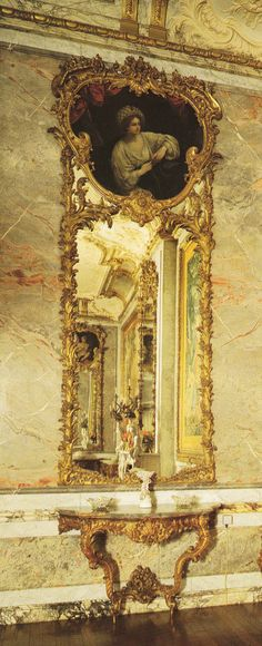 Giltwood looking-glass carved by Nicolas Pineau and Charles Bernard, 1730. Book: French Interiors of the 18th century by John Whitehead.
