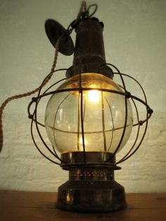 upcycled hanging oil lamp. $250.00, via Etsy.