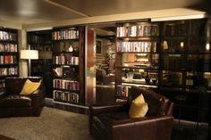 My obsession with the TV show Castle continues. Of course Richard Castle has an awesome New Y. Loft, Bookshelves, Bookcase, Richard Castle, Dream Library, Luxury Apartments, Home Kitchens, Liquor Cabinet, Architecture Design