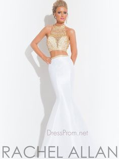 Show off your amazing figure in this form fitting Rachel Allan two piece prom dress. The two piece Rachel Allan prom dress 6870 has a high neckline, heavily beaded top, and the taffeta skirt is accented with a beaded waistband. This Rachel Allan dress completes its look with a trumpet skirt and a razor back. Finish this stylish two piece Rachel Allan formal dress with chunky rhinestone earrings and matching bracelet at DressProm.net. Features: Silhouette: Trumpet Neckline: High Neckline ...