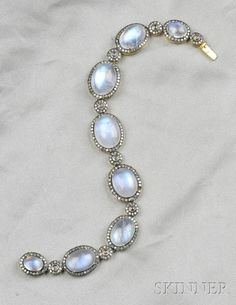 Moonstone and Diamond Bracelet, each link set with oval cabochon moonstones spaced by rose-cut diamonds, framed by single-cut diamond melee set in black patinated silver-topped 18kt gold mounts, approx. total wt. 2.00 ct