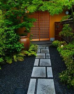 A few simple elements are all it takes to bring a bit of Japanese Tea Garden to your design. Natural or understated hardscaping, limited palette and negative space accented by only one focal point from any particular view will achieve this.