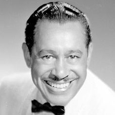 "Singer and bandleader Cab Calloway was born in Rochester, New York, in 1907. He learned the art of scat singing before landing a regular gig at Harlem's famous Cotton Club. Following the enormous success of his song ""Minnie the Moocher"" (1931), Calloway became one of the most popular entertainers of the 1930s and '40s. He appeared on stage and in films before his death in 1994, at age 86, in Hockessin, Delaware."