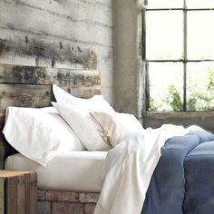 Rustic farm bedroom. Love the headboard!