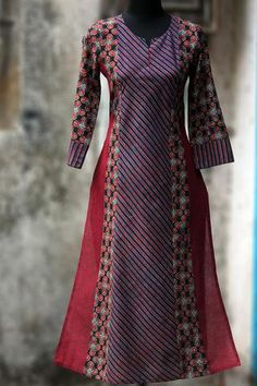 a long kurta with ajrakh in ruby colours & mangalgiri in side kalis, makes it a perfect work wear! this kurta has traditional hand embroidery (lattice sti Kurti Neck Designs, Salwar Designs, Blouse Designs, Dress Designs, Pakistani Dresses, Indian Dresses, Indian Outfits, Kurta Patterns, Dress Patterns