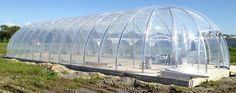 Biodome greenhouse completed with ETFE pneumatic pillow covering; includes automated energy efficient inflator