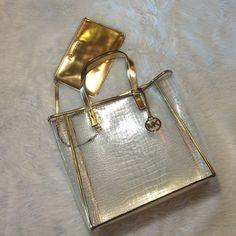 "Selling this ""LISTING MK Clear W/Gold Trim Tote Bag"" in my Poshmark closet! My username is: cindyciara. #shopmycloset #poshmark #fashion #shopping #style #forsale #Michael Kors #Handbags"