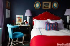 In a small New York City apartment, Nick Olsen designed a Moorish arched headboard in shiny red leather with lavender piping to contrast with the bedroom's matte walls in Fine Paints of Europe Eurolux Interior Matte in Navy Blue. A Directoire-style desk doubles as a night table. Vintage chair covered in a suede from Global Leathers. Bed linens, Frette.   - HouseBeautiful.com