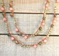 Gemstone & crystal crochet necklace. 6mm unakite and 6mm pink quartz beads are mixed with sparkling faceted Czech crystals then tightly crocheted on coral colored nylon cord. Gorgeous combination of pink and green, plus the sparkle of crystal. Stunning and unique color combination.