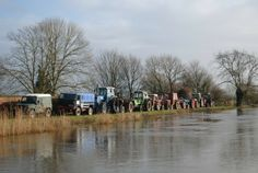 Farmers in Burrowbridge, Somerset, stage a demonstration against the failure of the Environment Agency to dredge rivers, which they say would prevent flooding.