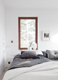 i love the wood window contrasting with the white walls