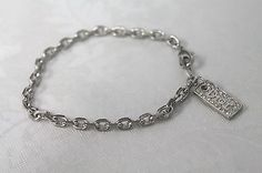CHRISTIAN DIOR CHARM BRACELET Rhinestone Dogtag-Style Silver Tone Link Chain - http://designerjewelrygalleria.com/christian-dior/christian-dior-charm-bracelet-rhinestone-dogtag-style-silver-tone-link-chain/