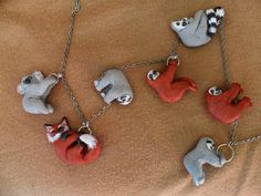This necklace has a miniature sloth hanging from the chain.  The chain of the necklace might be a bit different then the chain on the picture. …