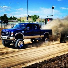 [Oh yeah!]  ... Down n dirty with a tricked out, torqued up truck!  Can't you just hear that engine wailin' ?!