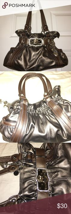 Kathy Van Zeeland hobo style purse Great condition on the outside lipstick stain on the inside(which you can't see) but no rips no tears NON smoker it's a bronze color Kathy Van Zeeland Bags Hobos