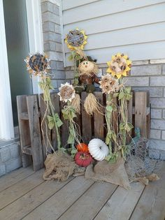 falling for pumpkins and sunflowers, curb appeal, gardening, outdoor living, repurposing upcycling, seasonal holiday decor, I got the pattern for the sunflowers from a 1997 Country Marketplace magazine I had planned on making them back then but never got around to it Those are dryer duct pumpkins I also made laying below the sunflowers